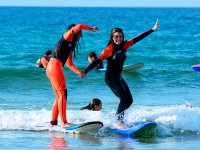 Students helping each other on the surfboards
