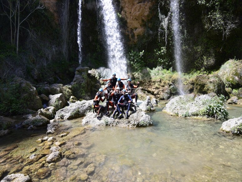 Group in the waterfall