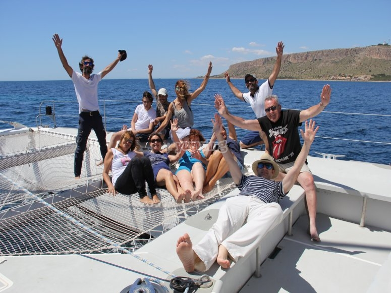 Group of friends in the catamaran at Costa Blanca
