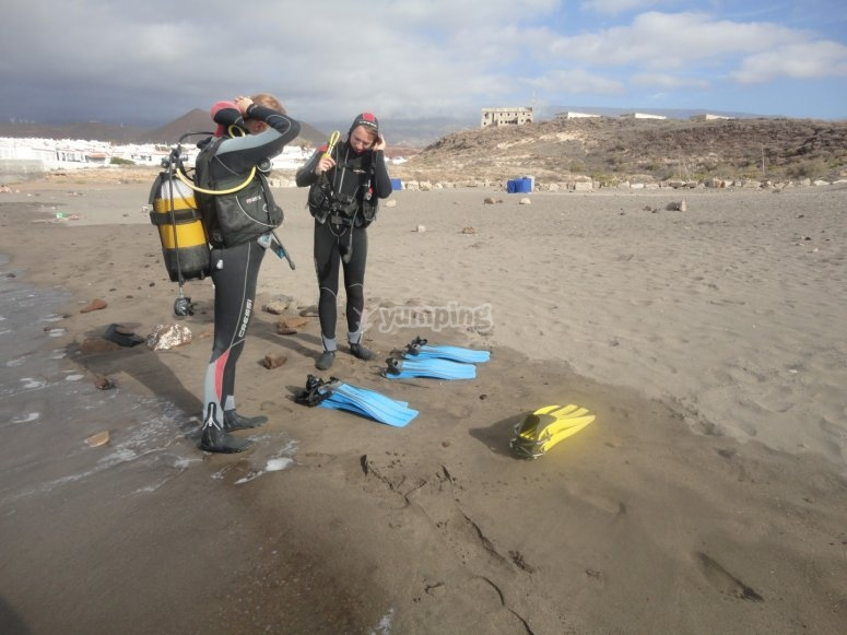 Putting on the equipment to go diving