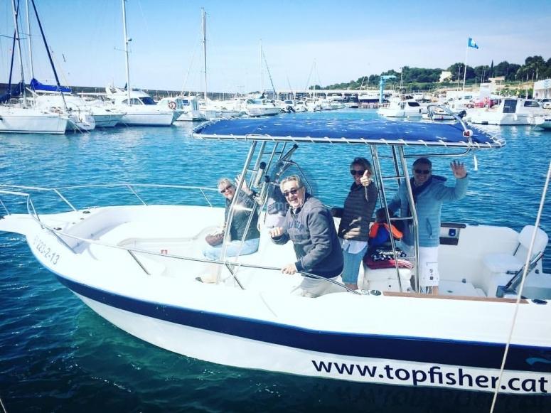 A bordo de lancha Top fisher