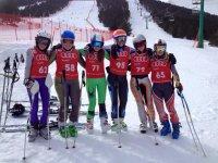 grupo de esquiadoras