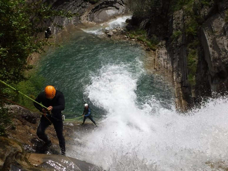 Rappelling next to the water