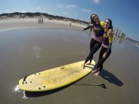 Girls on the board in the sand