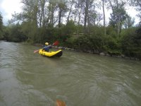 in the river with the canoe
