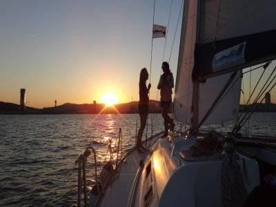Romantic sunset in sailboat, Barcelona