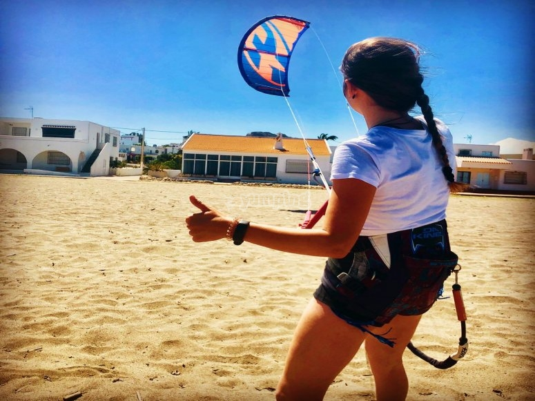 Girl saying hello whilst kitesurfing