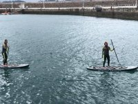 Practicing paddle surf with friends