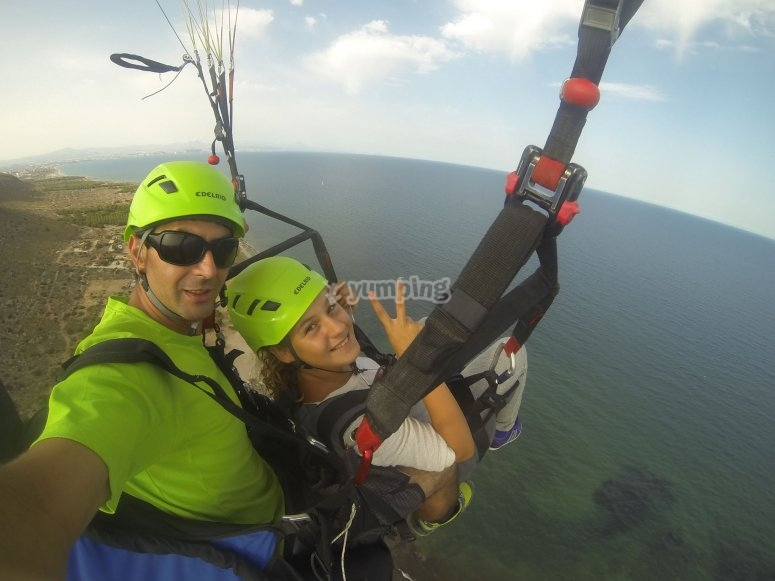 Two-seater paraglide with a girl