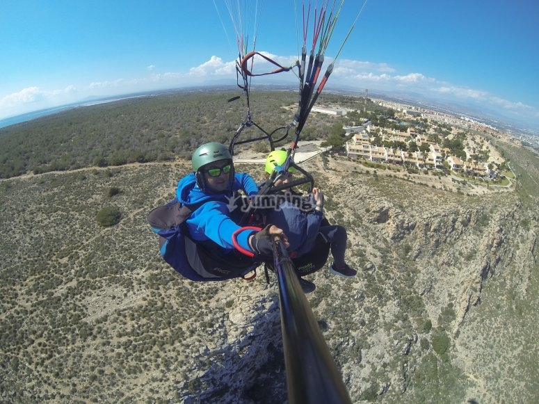 Between the lighthouse and urbanization whilst paragliding