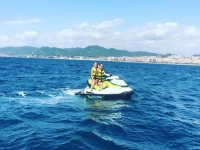 Girl and boy jet ski