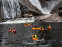 Fleet of kayaks reaching the waterfall