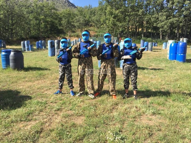 Blue team posing with the guns