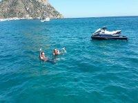 Swiming next to the jet ski in Benidorm