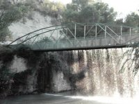 water falling from a bridge