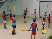 children learning the techniques of canoeing