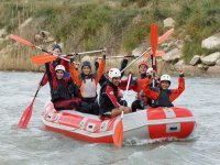 family in a boat practicing rafting