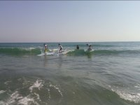 Surfing students in Gandia