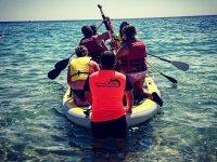 Paddle surfing on the coast Dorada