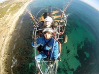 Paramotor flying over the coast