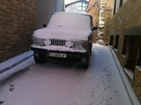 Our snow-covered SUV