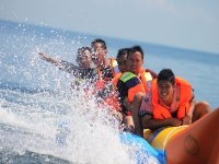 Group of friends in a banana boat
