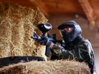 Playing indoor paintball