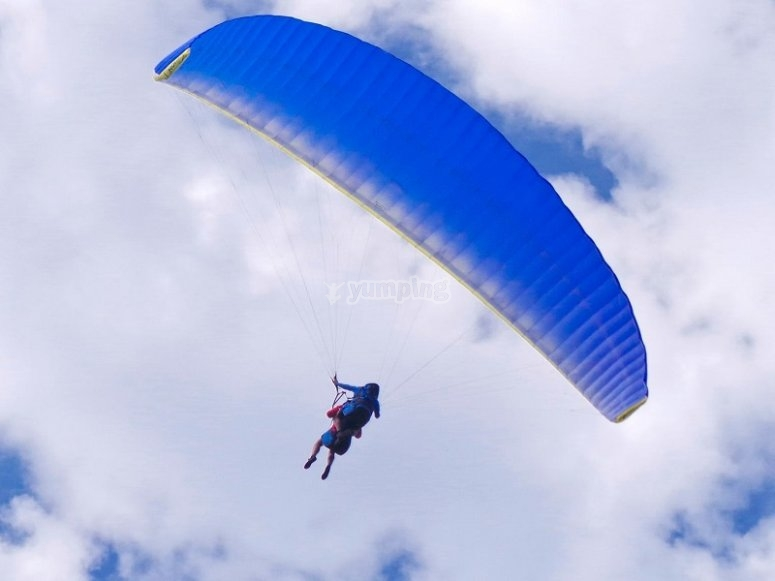Paraglide among clouds