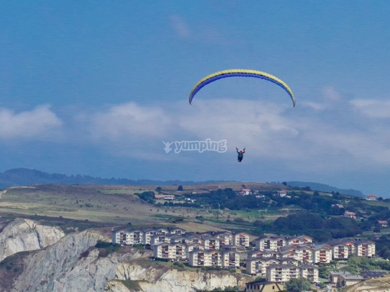 Paraglide flight over villages