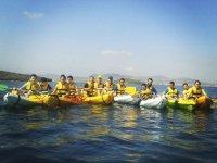 Friends kayaking around La Manga