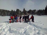 Grupo en raqueta de nieve