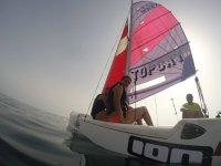 Students of sailing on the catamaran