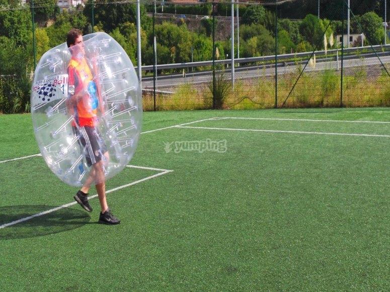 Zorbing football player