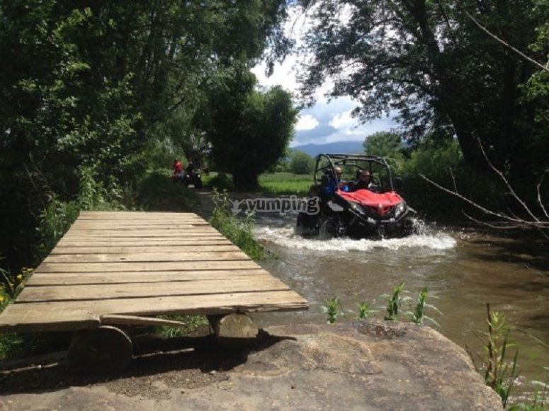 All-terrain vehicle crossing the river
