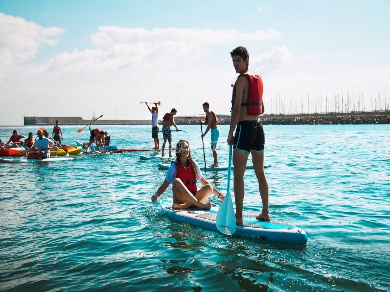 College practicing paddle surfing