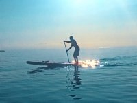 Paddle surfing at the open sea