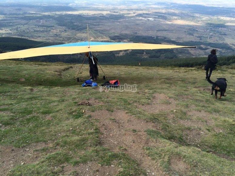 Hang gliding next to a hillside