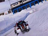 Porsche maneuvering on the snow