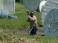 boy in a field of paintball playing