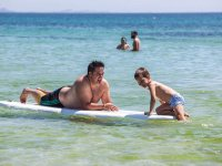 Father and son enjoying an afternoon of paddle surfing