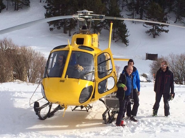 Next to the helicopter in the snow