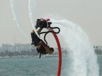 man doing a somersault while doing flyboard