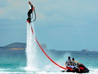 man flying the waters while practicing flyboard