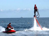 jet ski and man practicing flyboard