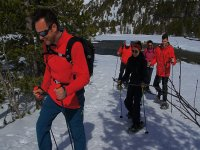Equipped with snowshoes and poles