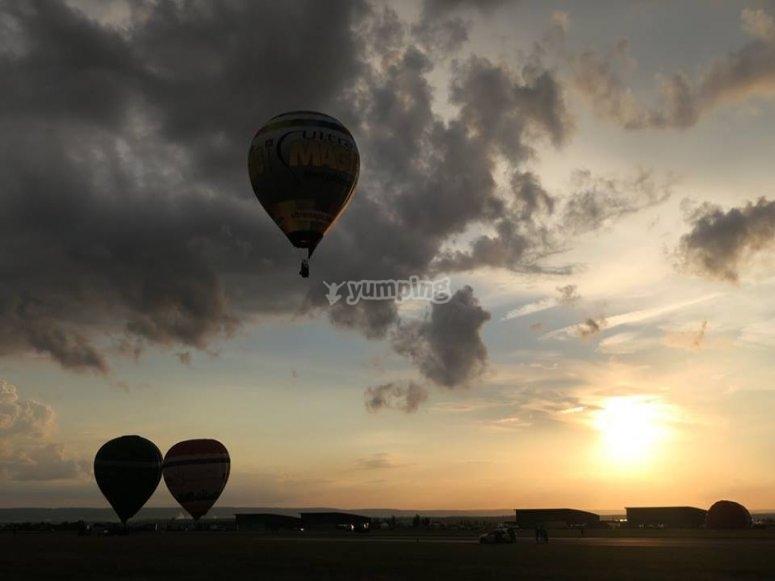 A hot air balloon ride at dusk