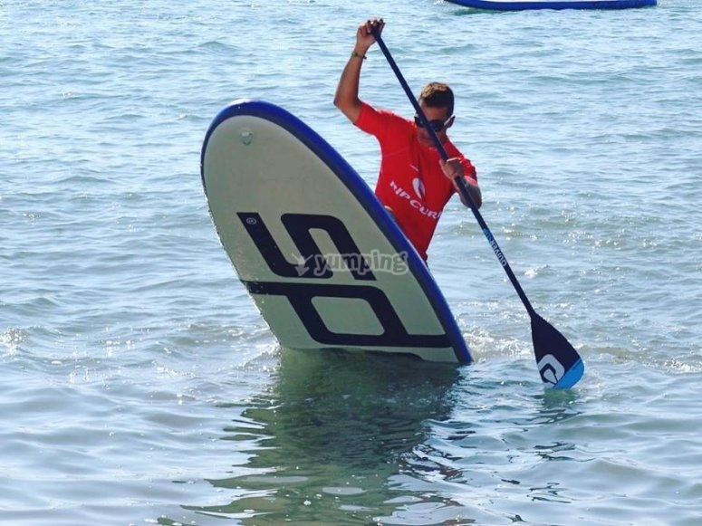 Doing paddle surf