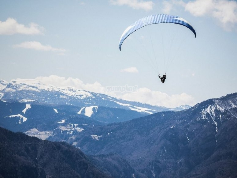 Paraglider flight surrounded by nature Extremadura