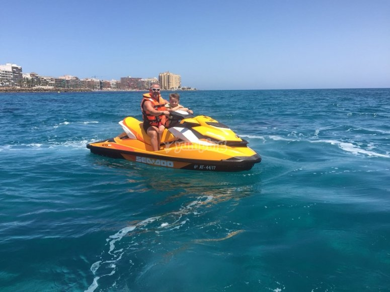 Father and son on the jet ski