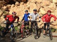 Adventurers riding a bike